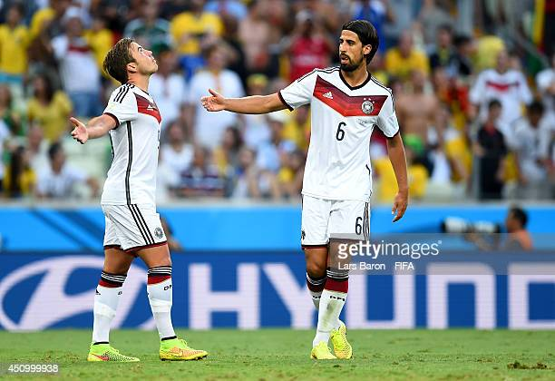 Mario Goetze of Germany celebrates scoring his team's first goal with his teammate Sami Khedira during the 2014 FIFA World Cup Brazil Group G match...