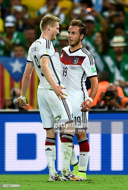 Mario Goetze of Germany celebrates scoring his team's first goal with his teammate Andre Schuerrle during the 2014 FIFA World Cup Brazil Final match...