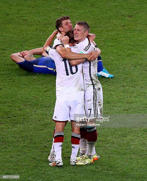 Mario Goetze of Germany celebrates with teammates after scoring his team's first goal in extra time during the 2014 FIFA World Cup Brazil Final match...