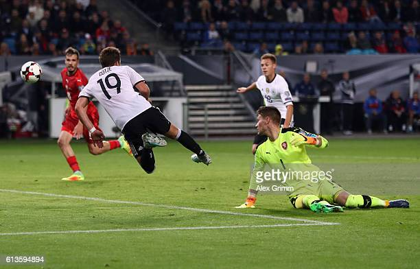 Mario Goetze of Germany is challenged by goalkeeper Tomas Vaclik of Czech Republic during the FIFA World Cup 2018 qualifying match between Germany...