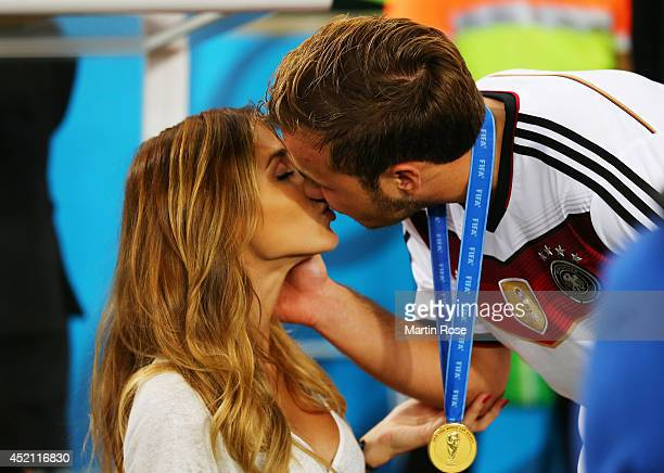 Mario Goetze of Germany kisses girlfriend AnnKathrin Brommel after defeating Argentina 10 in extra time during the 2014 FIFA World Cup Brazil Final...