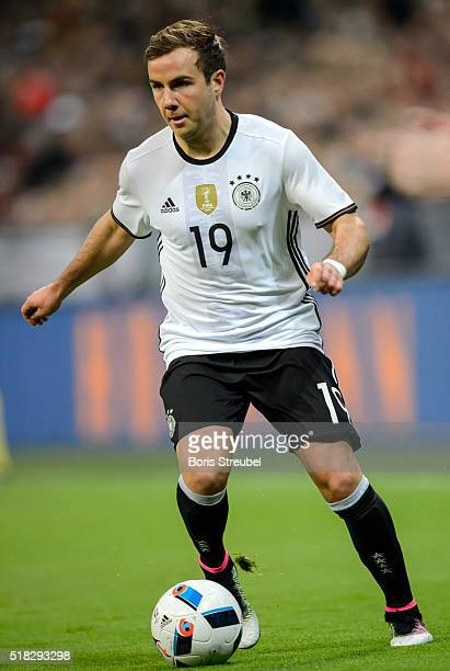 Mario Goetze of Germany runs with the ball during the International Friendly match between Germany and Italy at Allianz Arena on March 29 2016 in...