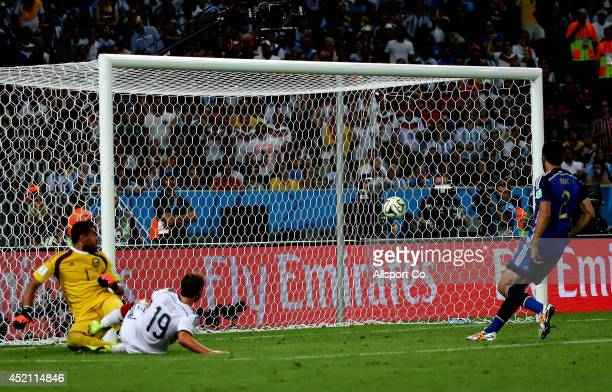Mario Goetze of Germany scores against Argentina during extra time during the 2014 FIFA World Cup Brazil Final match between Germany and Argentina at...