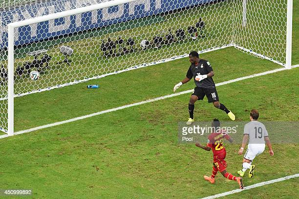 Mario Goetze of Germany scores his team's first goal past goalkeeper Fatawu Dauda of Ghana during the 2014 FIFA World Cup Brazil Group G match...