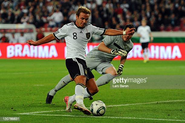 Mario Goetze of Germany scores his teams second goal during the International Friendly match between Germany and Brazil at MercedesBenz Arena on...