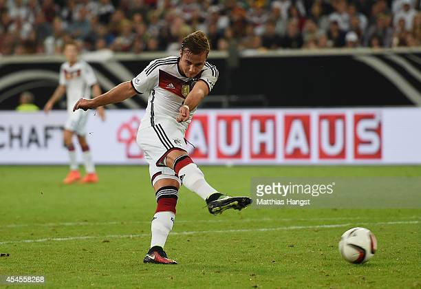 Mario Goetze of Germany scores his team's second goal during the international friendly match between Germany and Argentina at EspritArena on...