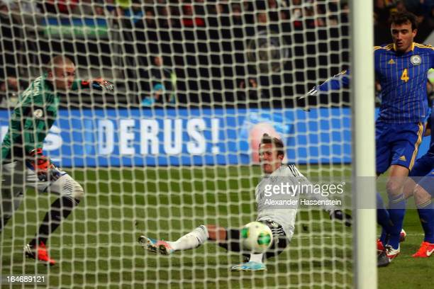 Mario Goetze of Germany scores the 2nd team goal during the FIFA 2014 World Cup qualifier group C match between Germany and Kazakhstan at...
