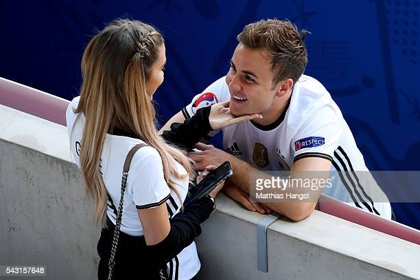 Mario Goetze of Germany talks with his girlfriend AnnKathrin Broemmel after the UEFA EURO 2016 round of 16 match between Germany and Slovakia at...