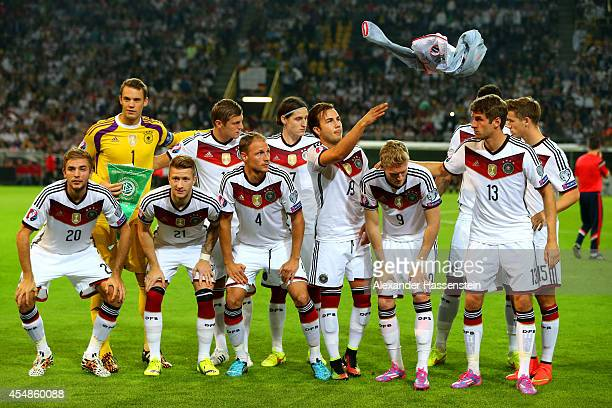 Mario Goetze of Germany throws his jacket away as he prepares to pose with the rest of the team for a group photo before the EURO 2016 Group D...
