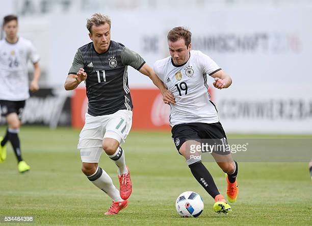 Mario Goetze of Germany vies with Felix Lohkemper of Germany U20 during a friendly match as part of their training camp on May 26 2016 in Ascona...