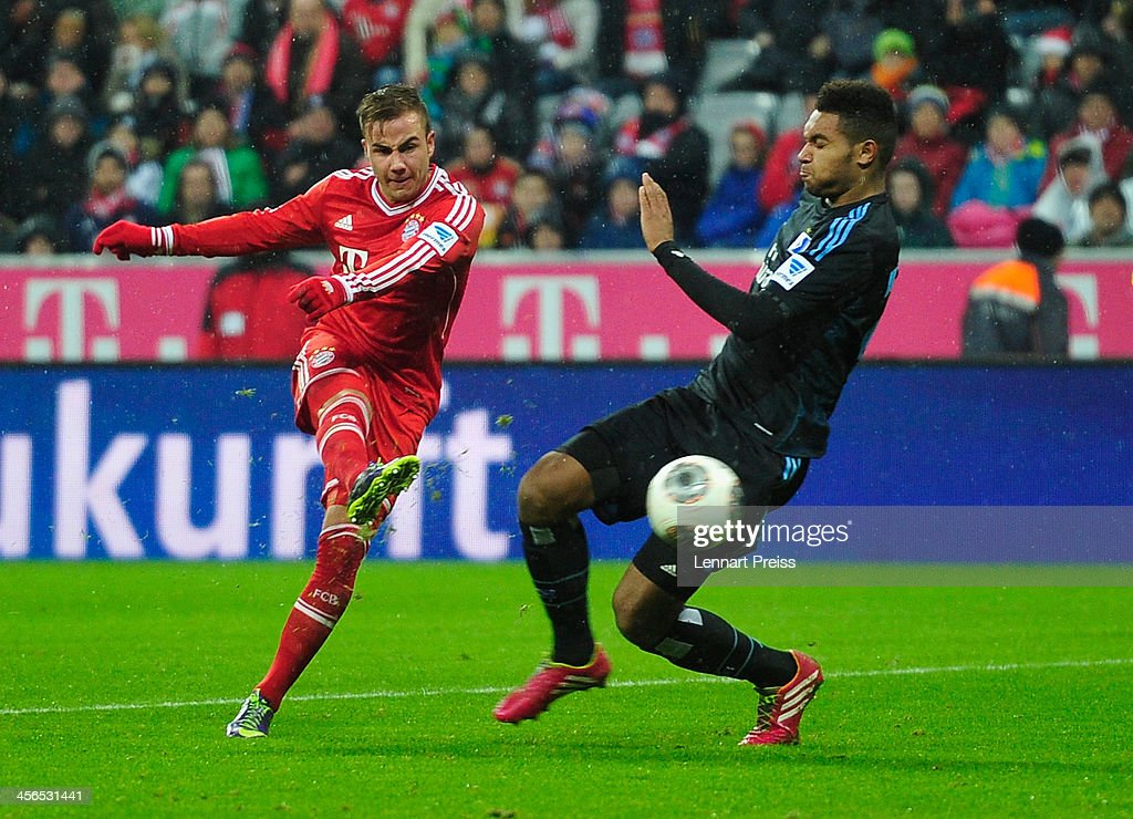 Mario Goetze (L) of Muenchen scores the team's second goal during the Bundesliga match between FC Bayern Muenchen and Hamburger SV at Allianz Arena on December 14, 2013 in Munich, Germany.