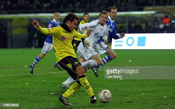 Mario Goetze of Schalke shoots on goal during the Bundesliga match between Borussia Dortmund and FC Schalke 04 at Signal Iduna Park on February 4...
