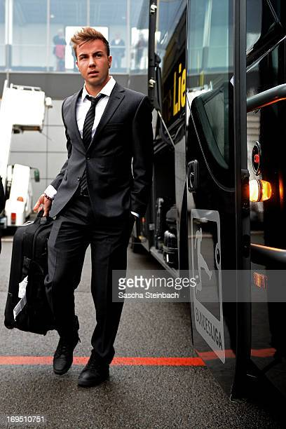 Mario Goetze walks on the tarmac as the Borussia Dortmund return to Dortmund Airport after UEFA Champions League Final on May 26 2013 in Dortmund...