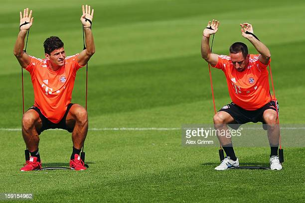 Mario Gomez and Franck Ribery exercise during a Bayern Muenchen training session at the ASPIRE Academy for Sports Excellence on January 9, 2013 in...