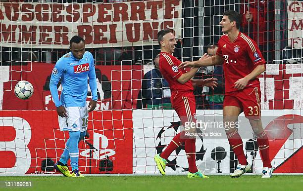 Mario Gomez and Franck Ribery of Bayern Muenchen celebrateGomez' hird goal as Juan Zuniga of Napoli reacts during the UEFA Champions League Group A...
