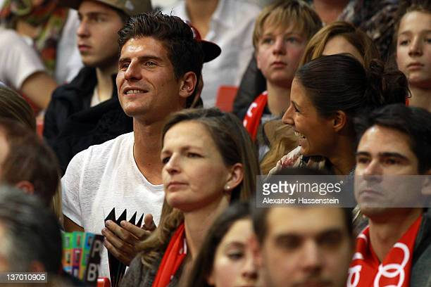Mario Gomez and girlfriend Silvia Meichel attend the Beko Basketball match between FC Bayern Muenchen and EWE Baskets Oldenburg at AudiDome on...