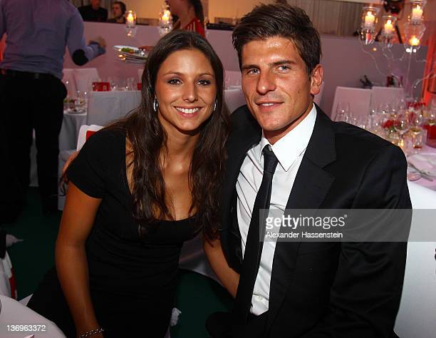 Mario Gomez and girlfriend Silvia Meichel attend the Uli Hoeness' 60th birthday celebration at Postpalast on January 13 2012 in Munich Germany