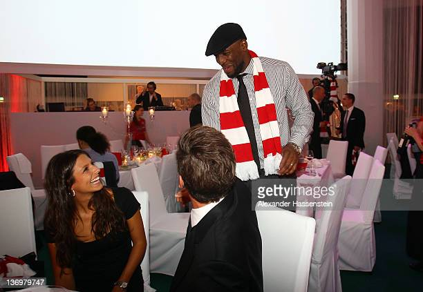 Mario Gomez and girlfriend Silvia Meichel talk to Darius Hall during the Uli Hoeness' 60th birthday celebration at Postpalast on January 13 2012 in...