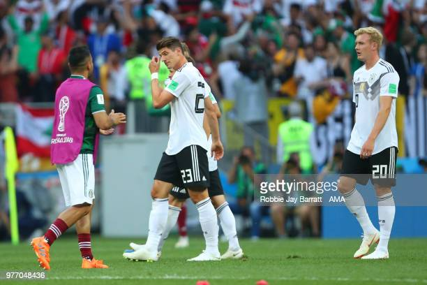 Mario Gomez and Julian Brandt of Germany look dejected at the end of the 2018 FIFA World Cup Russia group F match between Germany and Mexico at...