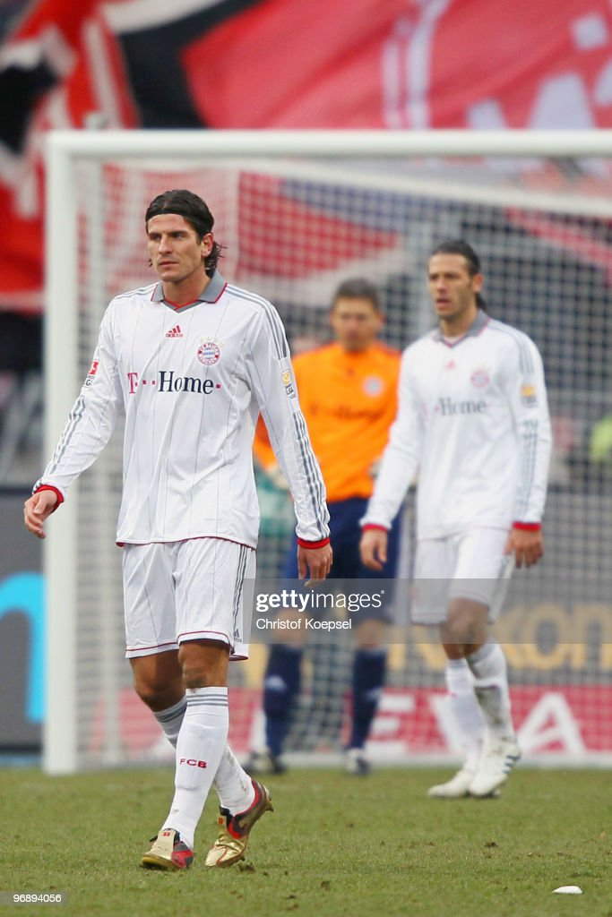 Mario Gomez and Martin Demichelis of Bayern look dejected after receiving the first goal of Nuernberg during the Bundesliga match between 1. FC Nuernberg and FC Bayern Muenchen at Easy Credit Stadium on February 20, 2010 in Nuremberg, Germany.