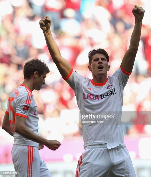 Mario Gomez and Thomas Mueller of Bayern Muenchen celebrate Gomez' first goal during the Bundesliga match between FC Bayern Muenchen and VfB...