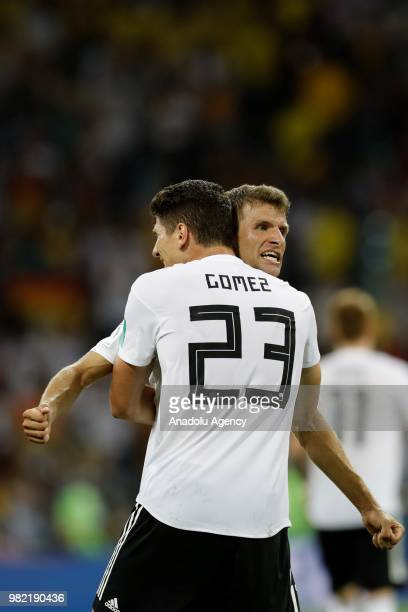 Mario Gomez and Thomas Muller of Germany celebrate after winning the match at the end of the 2018 FIFA World Cup Russia Group F match between Germany...
