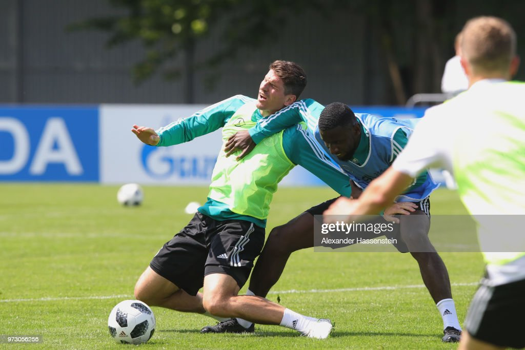 Mario Gomez (L) battles for the ball with Antonio Ruediger during the Germany training session ahead of the 2018 FIFA World Cup at CSKA Sports Base on June 13, 2018 in Moscow, Russia.