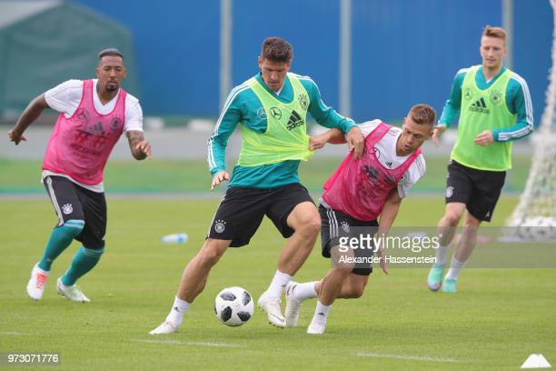 Mario Gomez battles for the ball with Joshua Kimmich during the Germany training session ahead of the 2018 FIFA World Cup at CSKA Sports Base on June...