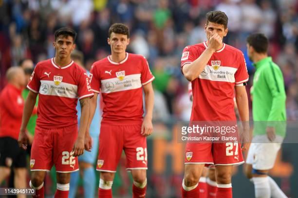 Mario Gomez Benjamin Pavard and Nicolas Gonzalez of VfB Stuttgart look dejected following their sides defeat in the Bundesliga match between FC...