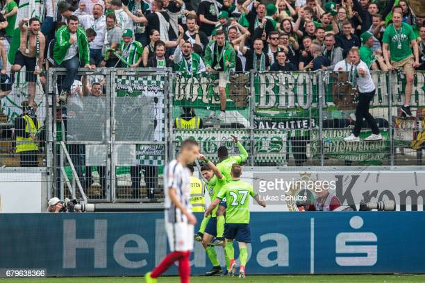 Mario Gomez celebrates his teams second goal with team mates and fans during the Bundesliga match between Eintracht Frankfurt and VfL Wolfsburg at...