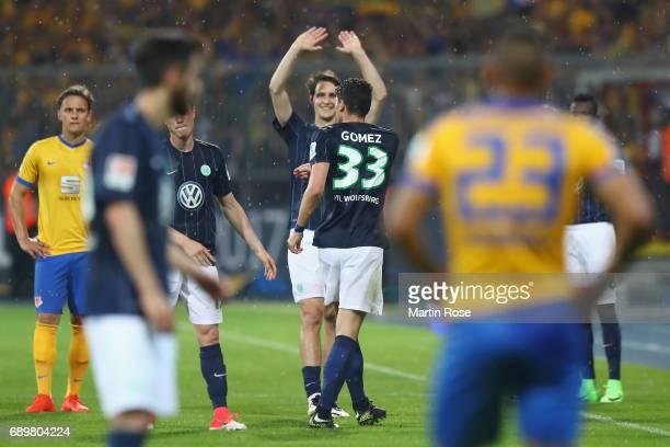 Mario Gomez celebrates with team mate Philipp Wollscheid before beingt substituted during the Bundesliga Playoff leg 2 match between Eintracht...