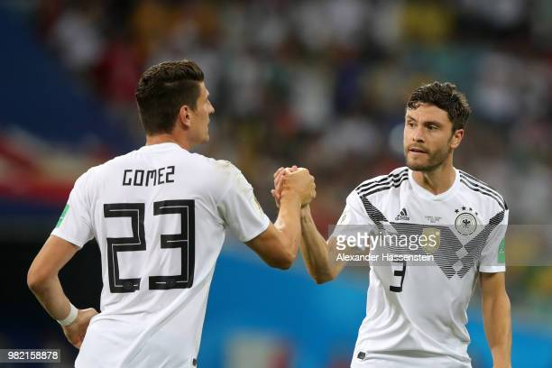Mario Gomez celebrates with teammate Jonas Hector affter their team's first goal during the 2018 FIFA World Cup Russia group F match between Germany...