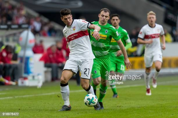 Mario Gomez Garcia of Stuttgart and Tony Jantschke of Moenchengladbach battle for the ball during the Bundesliga match between VfB Stuttgart and...