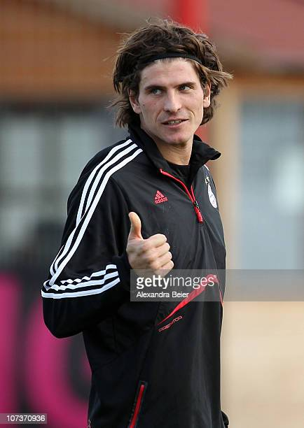 Mario Gomez gives a thumb up during a Bayern Muenchen training session ahead of the Champions League Group E match against FC Basel on December 7,...