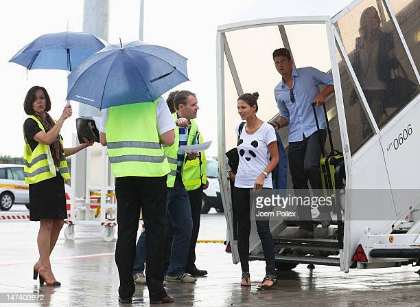 Mario Gomez his girlfriend Silvia Meichel and Sarah Brandner girlfriend of Bastian Schweinsteiger are pictured at the arrival at the airport on June...