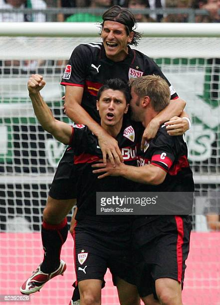 Mario Gomez ,Marica Ciprian and Thomas Hitzlsperger of Stuttgart celebrate after the 0-1 during the Bundesliga match between Borussia...