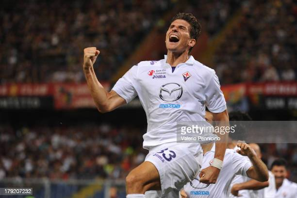 Mario Gomez of ACF Fiorentina celebrates after scoring his team's third goal during the Serie A match between Genoa CFC and ACF Fiorentina at Stadio...