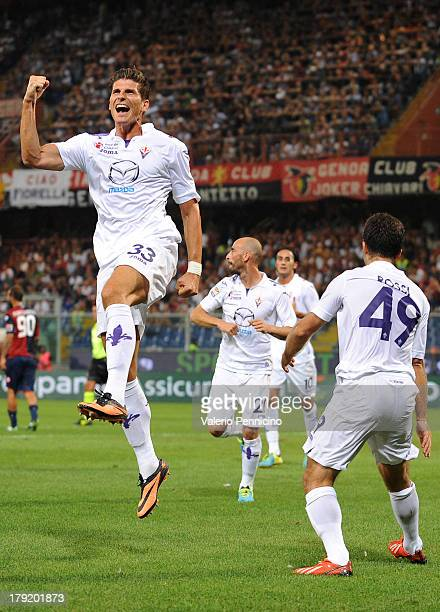 Mario Gomez of ACF Fiorentina celebrates the goal of his teammate Giuseppe Rossi during the Serie A match between Genoa CFC and ACF Fiorentina at...