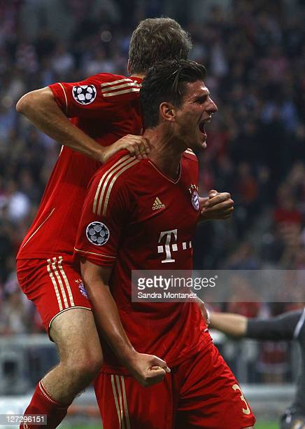 Mario Gomez of Bayern celebrates after scoring the opening goal during the UEFA Champions League group A match between FC Bayern Muenchen and...
