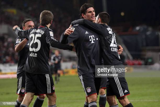 Mario Gomez of Bayern celebrates the first goal with Diego Contento of Bayern during the Bundesliga match between VfB Stuttgart and FC Bayern...