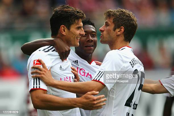 Mario Gomez of Bayern celebrates the second goal with David Alaba and Thomas Mueller of Bayernduring the Bundesliga match between 1 FC Kaiserslautern...