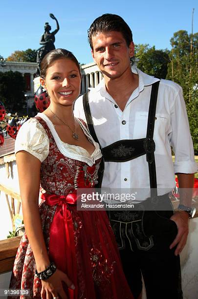 Mario Gomez of Bayern Muenchen and girlfriend Silvia Meichel attend the Oktoberfest beer festival at the Kaefer Wiesnschaenke tent on October 4 2009...