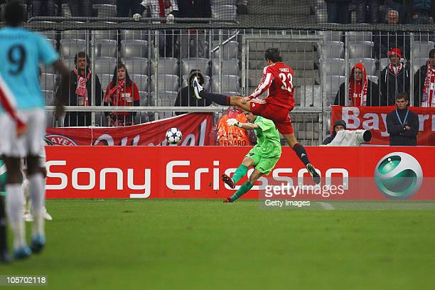 Mario Gomez of Bayern Muenchen battles for the ball with Eduard Stancioiu keeper of Cluj during the UEFA Champions League group E match between FC...