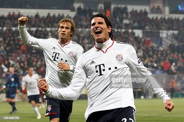 Mario Gomez of Bayern Muenchen celebrates after he scores his team's opening goal during the UEFA Champions League group E match between CFR 1907...