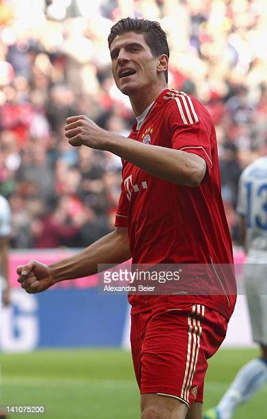 Mario Gomez of Bayern Muenchen celebrates his first goal during the Bundesliga match between FC Bayern Muenchen and 1899 Hoffenheim at Allianz Arena...