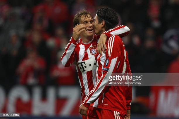 Mario Gomez of Bayern Muenchen celebrates scoring the 3rd team goal with his team mate Andreas Ottl during the UEFA Champions League group E match...