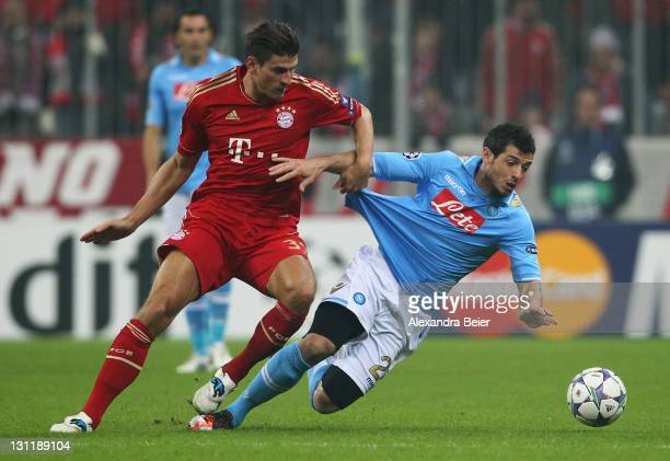 Mario Gomez of Bayern Muenchen fights for the ball with Blerim Dzemaili of Napoli during the UEFA Champions League Group A match between FC Bayern...