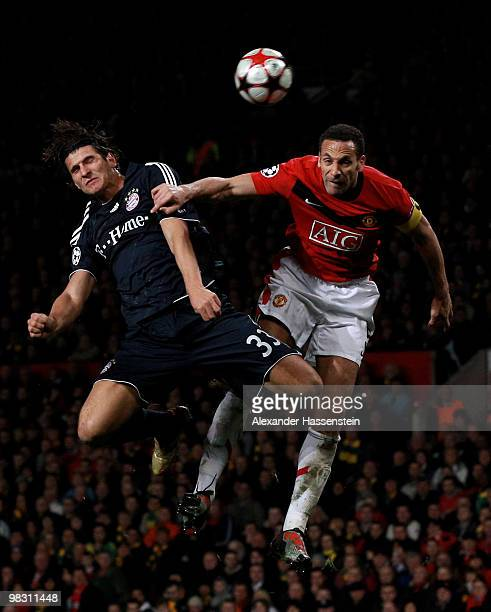 Mario Gomez of Bayern Muenchen goes up for a header with Rio Ferdinand of Manchester United during the UEFA Champions League Quarter Final second leg...
