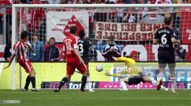 Mario Gomez of Bayern Muenchen scores his third goal against goalkeeper Rene Adler of Leverkusen during the Bundesliga match between FC Bayern...