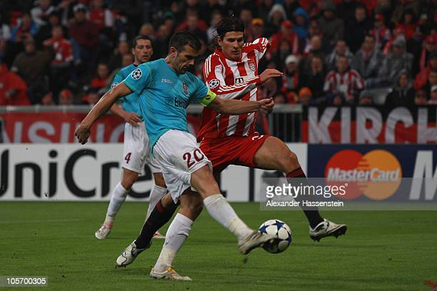 Mario Gomez of Bayern Muenchen scores the 3rd team goal against Cadu of Cluj during the UEFA Champions League group E match between FC Bayern...